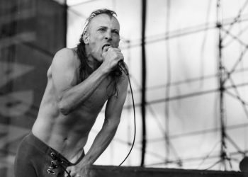 NORTH KINGSTOWN, RI - JULY 17: Vocalist Maynard James Keenan performs with Tool during a Lollapalooza tour stop at Quonset State Airport in North Kingstown, RI on Jul 17, 1993.  (Photo by Pam Berry/The Boston Globe via Getty Images)
