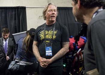 Metallica lead singer James Hetfield prepares to take the court to perform the Star Spangled Banner as the Golden State Warriors and Toronto Raptors face off in Game 3 of the NBA Finals at Oracle Arena in Oakland, Calif. Wednesday, June 5, 2019.