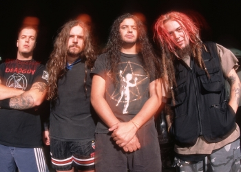 UNSPECIFIED - JANUARY 01:  Photo of Max CAVALERA and SEPULTURA and Igor CAVALERA and Andreas KISSER and Paulo JR; Posed group portrait L-R Igor Cavalera, Andreas Kisser, Paulo Xisto Pinto Jr and Max Cavalera  (Photo by Mick Hutson/Redferns)